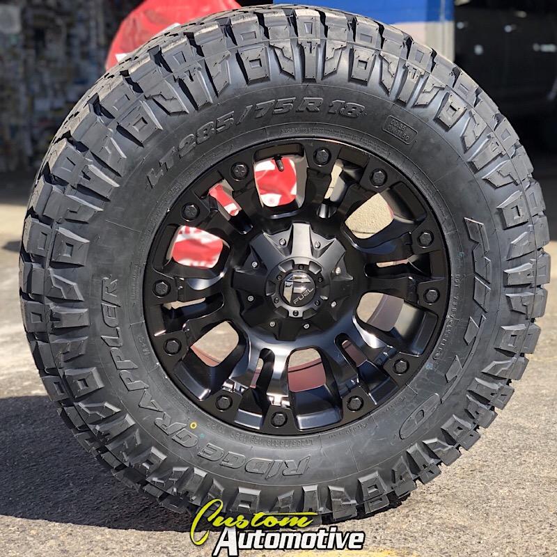 18x9 Fuel Vapor D560 Black - LT285/75r18 Nitto Ridge Grappler