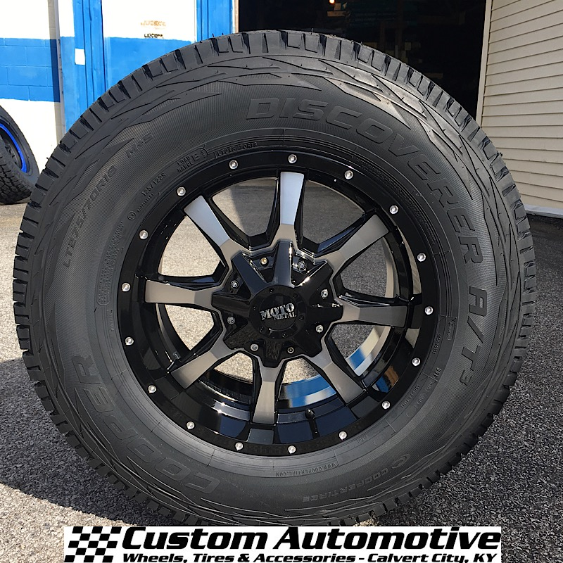 18x9 Moto Metal 970 Black and Machined - LT275/70r18 Cooper Discoverer A/T3