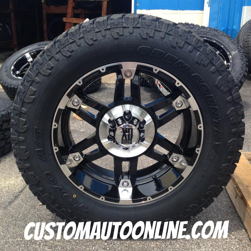 20x9 KMC XD Spy 797 Black - LT295/60r20 Toyo Open Country AT2 Extreme