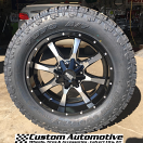 20x9 Moto Metal 970 Gloss Black and Machined - LT305/55r20 Toyo Open Country ATII Extreme